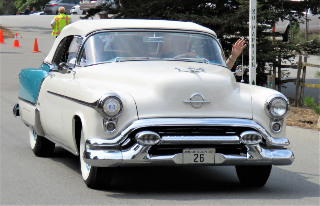 An Oldsmobile convertible on the road