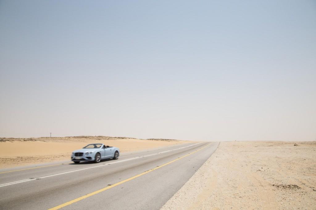 Bentley Continental GT races a train across Saudi Arabia