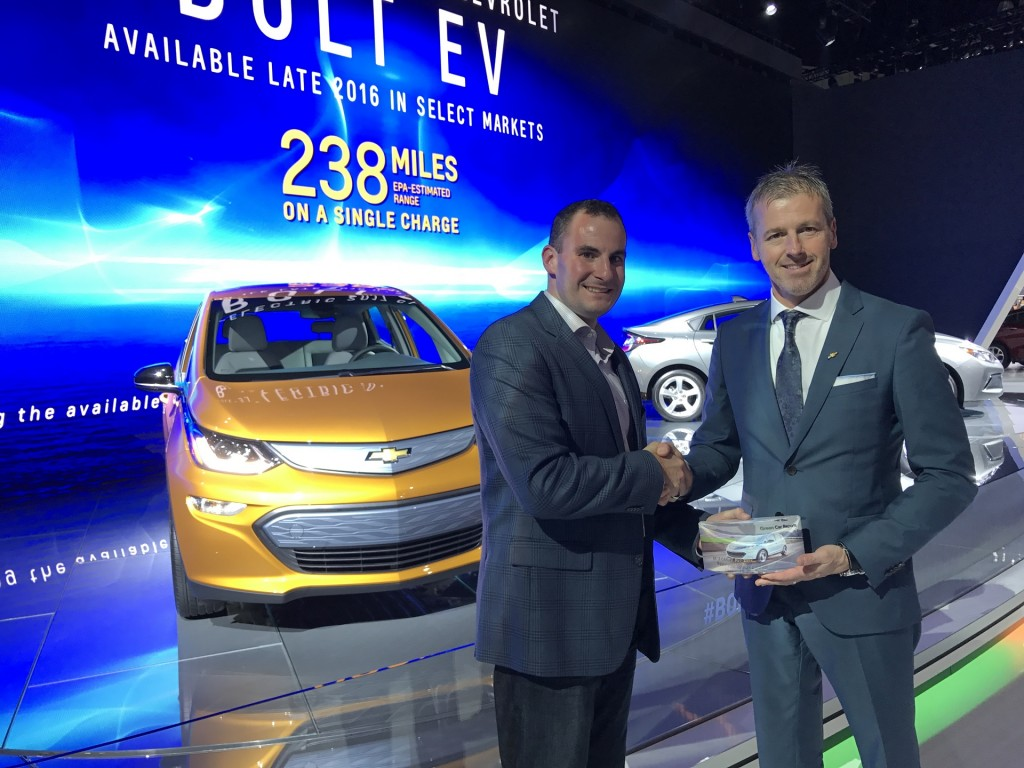 Chevrolet's Steve Majoros (R) accepts Green Car Reports 2017 Best Car To Buy award for Chevy Bolt EV