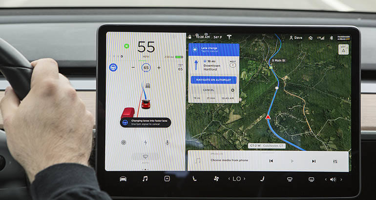 Tesla open to third party apps for its big center screens