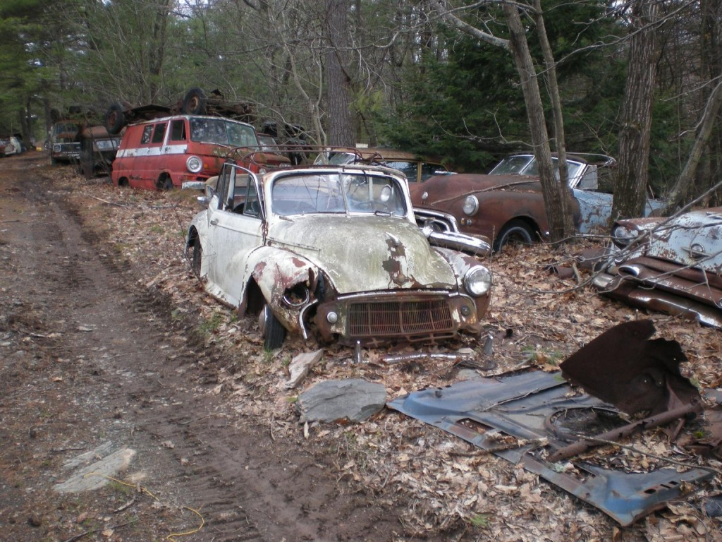 Image early 1950s morris minor tourer and other cars in for Outboard motor salvage yard