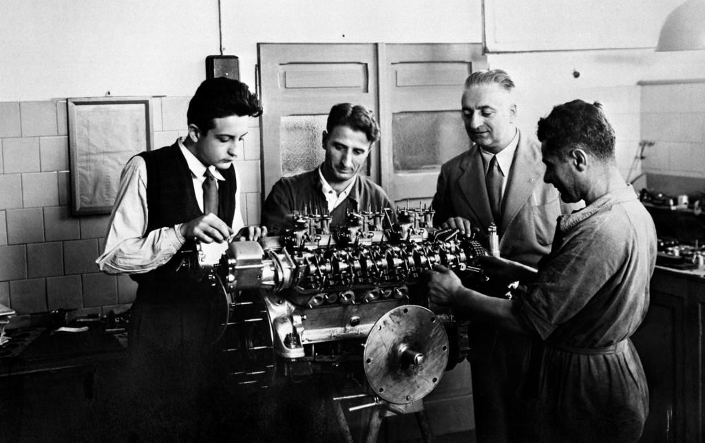 Enzo Ferrari oversees Gioacchino Colombo, Giuseppe Busso and Luigi Bazzi's work on a V-12 engine