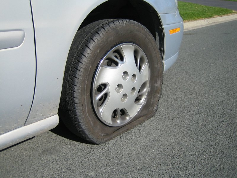 Flat tire, by flickr user Tiger Girl