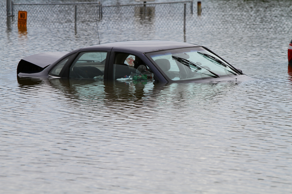 Flooded car in parking lot. Photo via Flickr user waitscm/CC2.0
