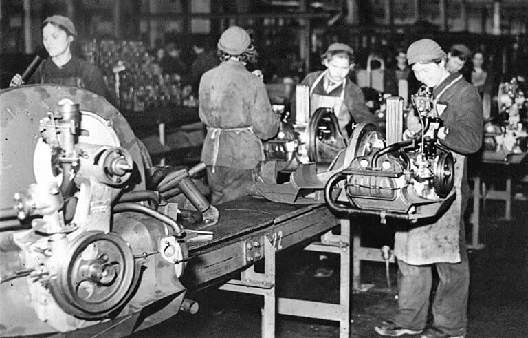 Forced female laborers assembling engines during WWII