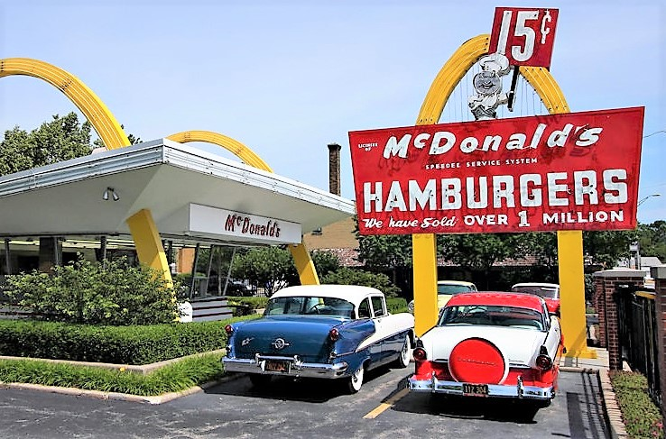 four classic American cars that stood outside the replica 1955 McDonald's restaurant