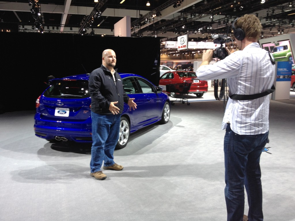 High Gear Media Team Shooting Video At 2011 Los Angeles Auto Show