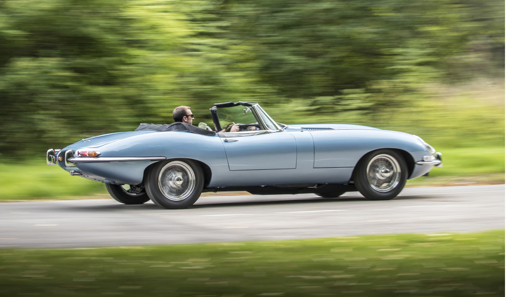 Prince Harry and Meghan Markle leave wedding in an electric E-Type