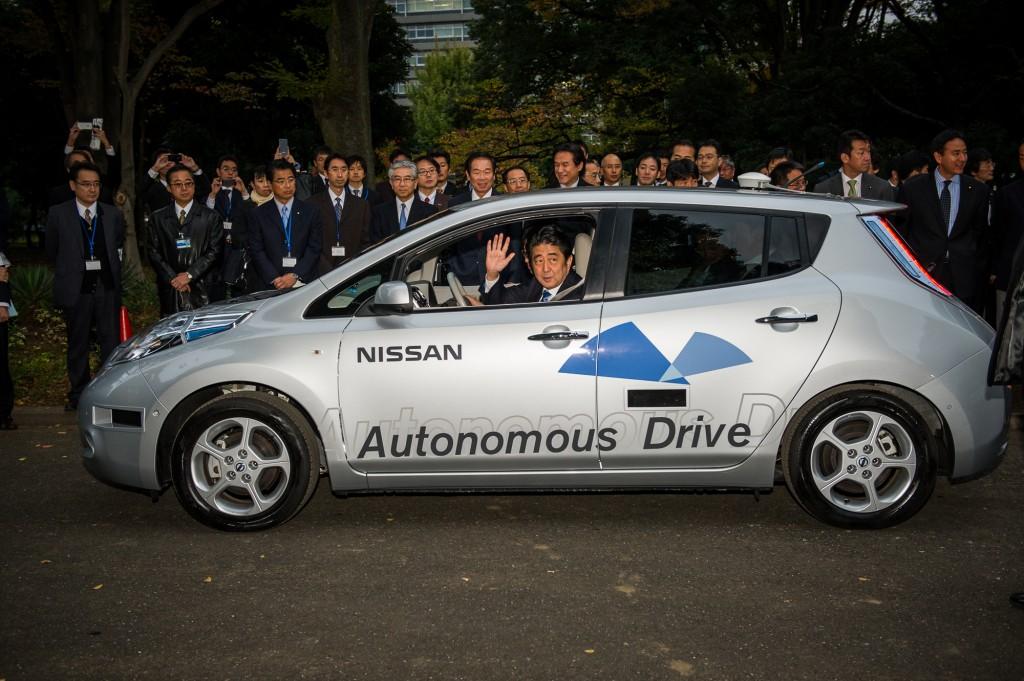 Japanese Prime Minister Shinzo Abe rides in an Autonomous Drive Nissan Leaf (November 9, 2013)