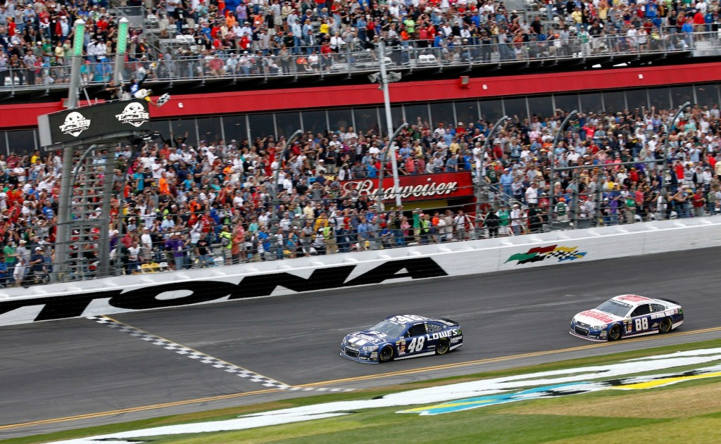 Jimmie Johnson beats Dale Earnhardt Jr to teh checkered flag - image: Harold Hinson for Chevrolet