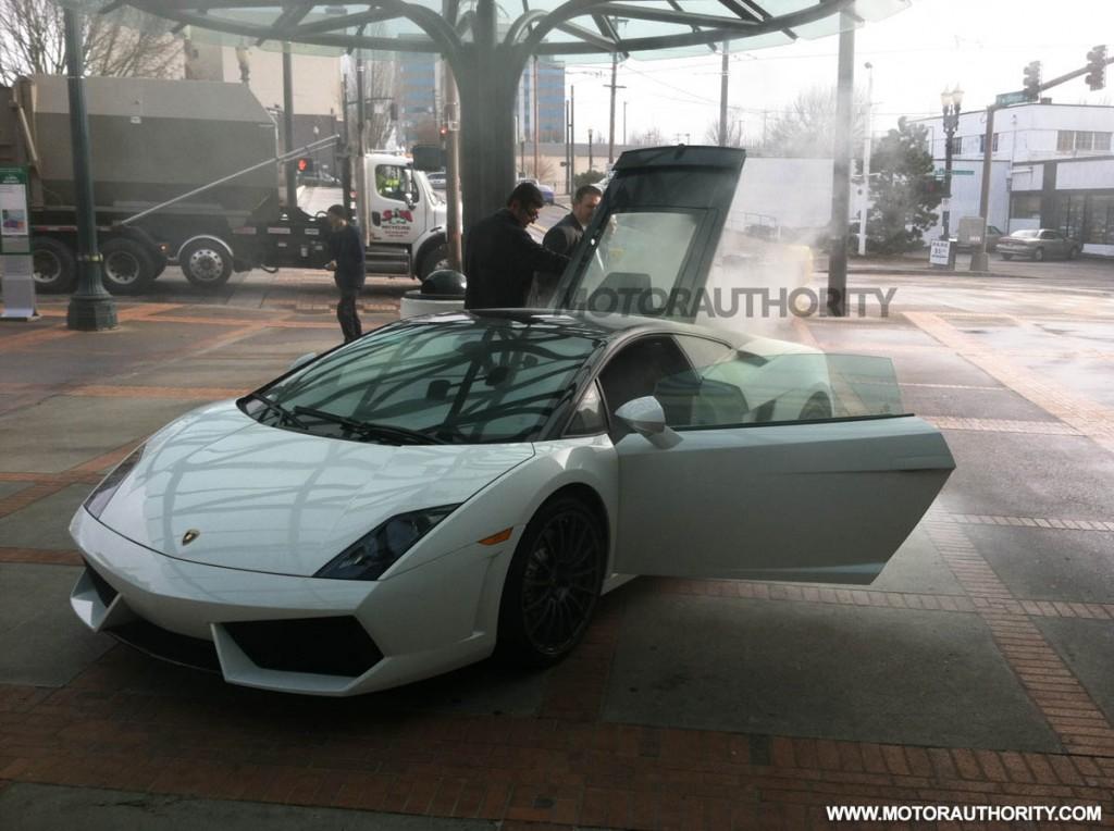 Lamborghini Gallardo on fire at 2012 Portland Auto Show. Photo credit Lary Coppola.