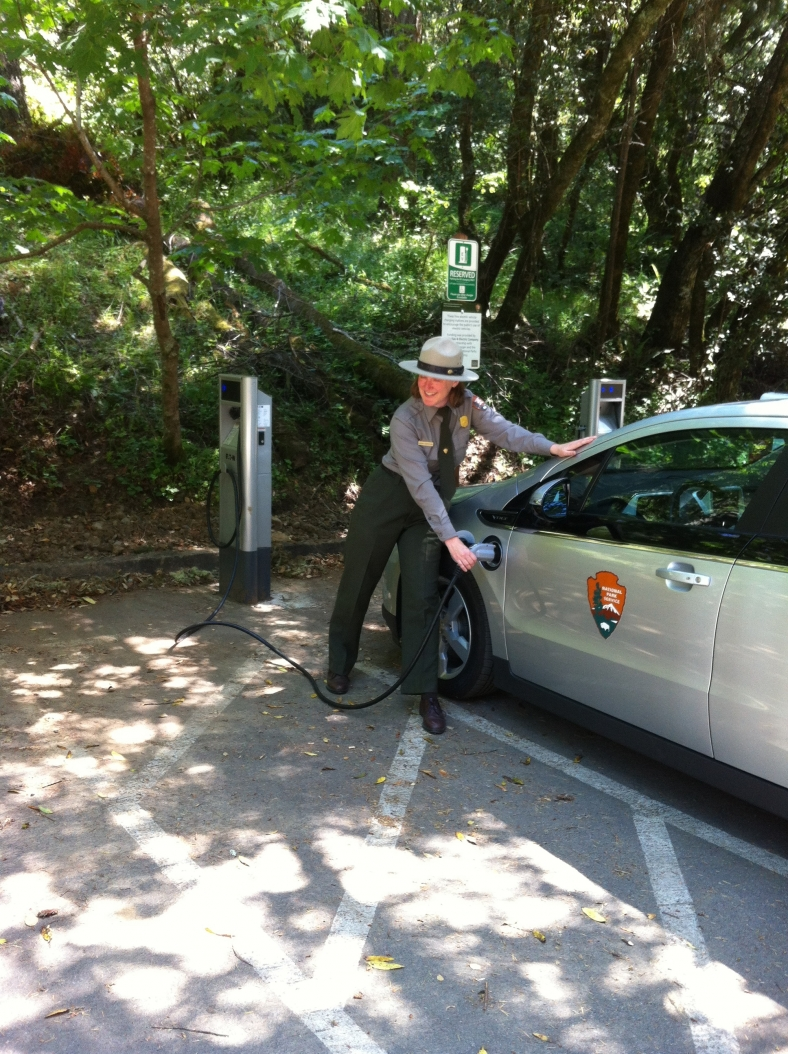 Park ranger charges a Chevrolet Volt at Golden Gate National Recreation Area