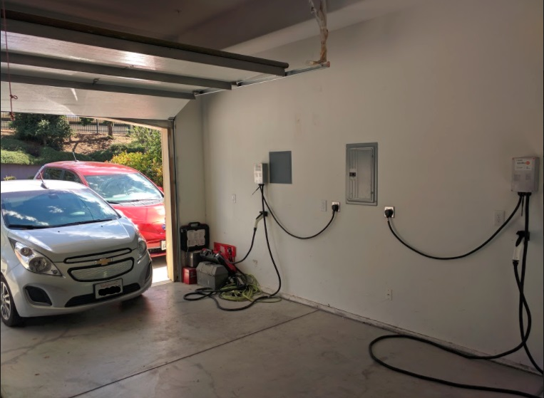 Electric-car charging stations in garage, Fremont, California   [image: Shiva Singh]