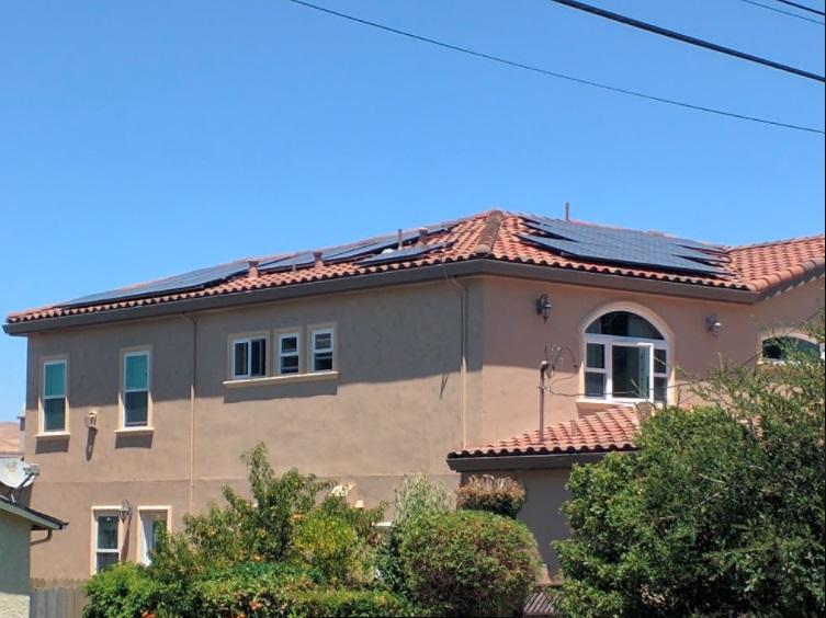 Photovoltaic solar panel installation on house, Fremont, California   [image: Shiva Singh]