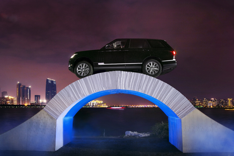 Range Rover Rides Up And Over A Bridge Of Paper: Video