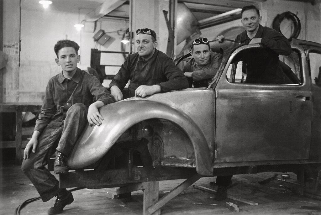 Reutter craftsmen work in 1938 on a prototype for the Volkswagen Type 1