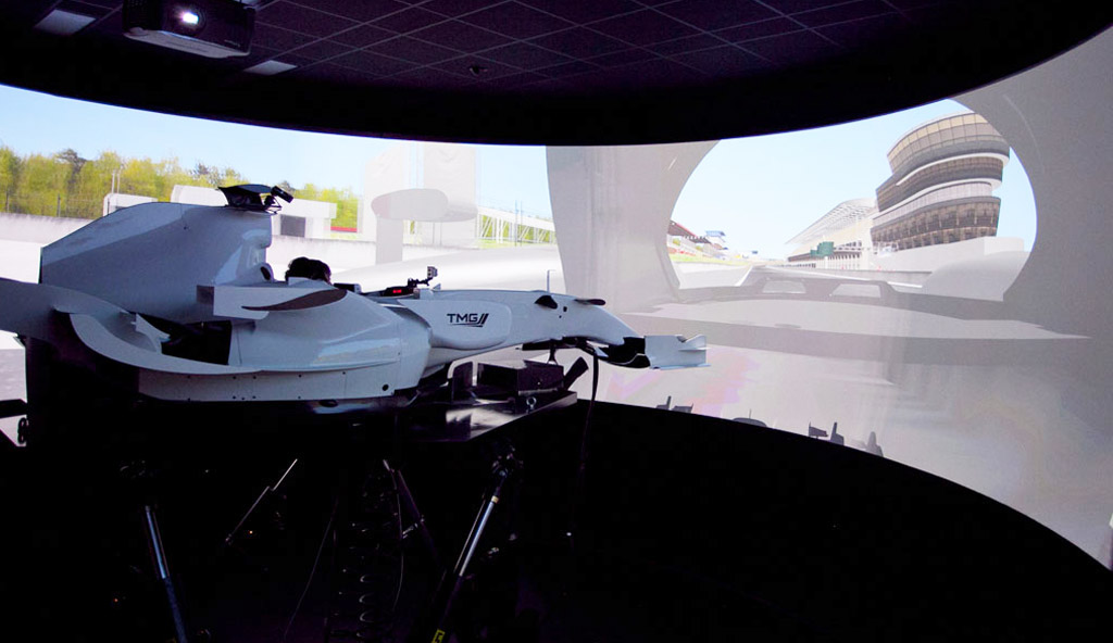 realistic f1 simulator ride puts fans in the cockpit: video