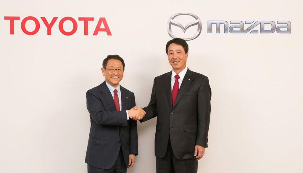 Toyota chief Akio Toyoda (left) and Mazda chief Masamichi Kogai