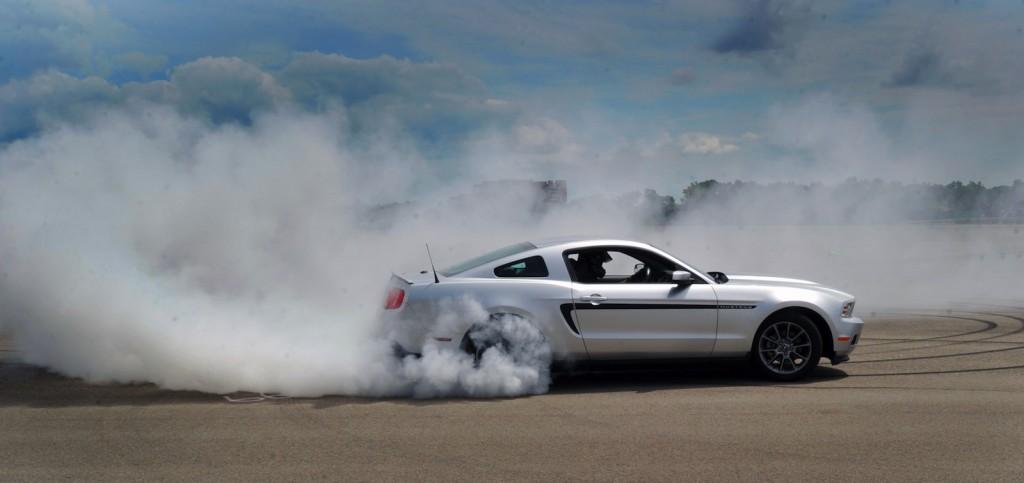 Vaughn Gittin Jr demonstrates a proper burnout - image: Ford Motor Company