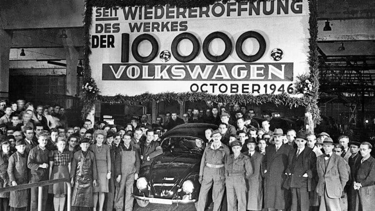 Workers gather as the 10,000th Beetle rolls of the assembly line