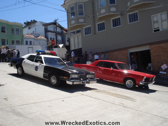 WreckedExotics.com GTO and Police Car