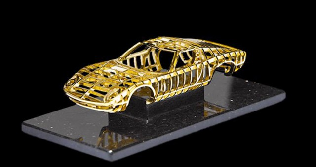 1:24 scale gold sculpture of a Lamborghini Miura crafted by Swiss artist Dante Rubli