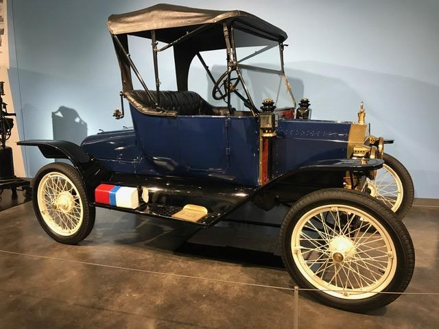1914 Ford Model T at LeMay America's Car Museum: red can for gasoline, blue for oil, white for water