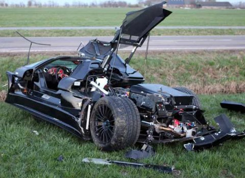 20-year-old crashes Gumpert Apollo supercar. Photo via Reuters.