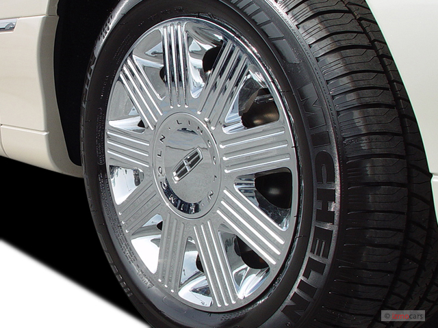 https://images.hgmsites.net/med/2003-lincoln-town-car-4-door-sedan-cartier-l-wheel-cap_100278522_m.jpg