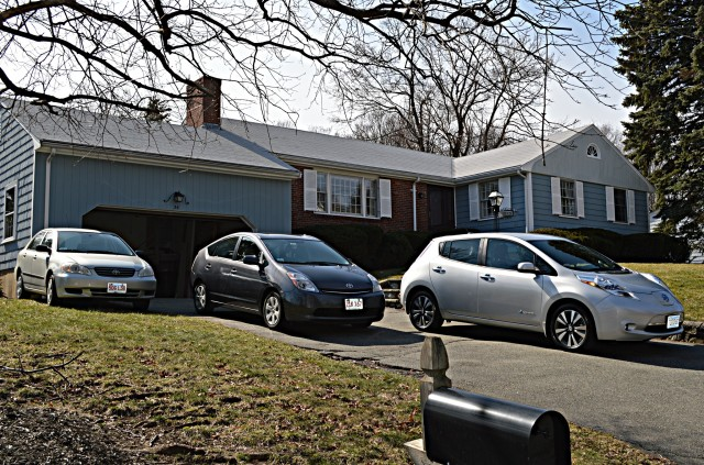 2004 Toyota Corolla, 2006 Toyota Prius, 2015 Nissan Leaf outside home [photo: John C. Briggs]