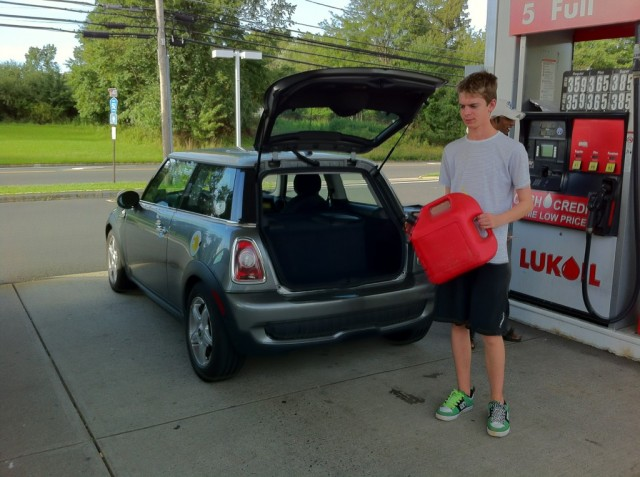 Filling up the Mini E at the gas station; photo, Michael Thwaite