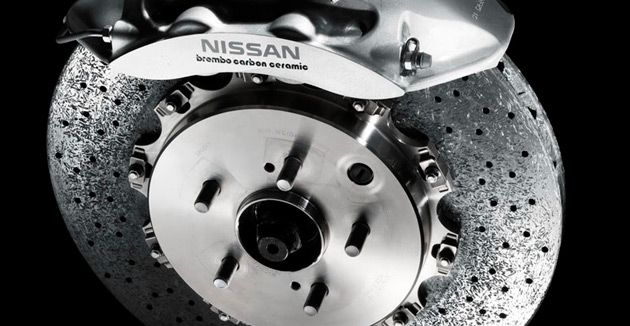Pictured is the carbon ceramic brake disc and caliper from the Nissan GT-R SpecV supercar
