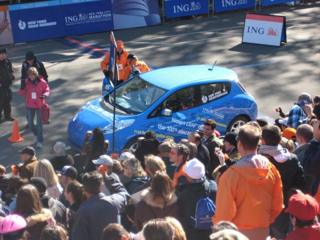 2011 Nissan Leaf electric car at NYC Marathon, Oct 2010, with Marathon CEO Mary Wittenberg