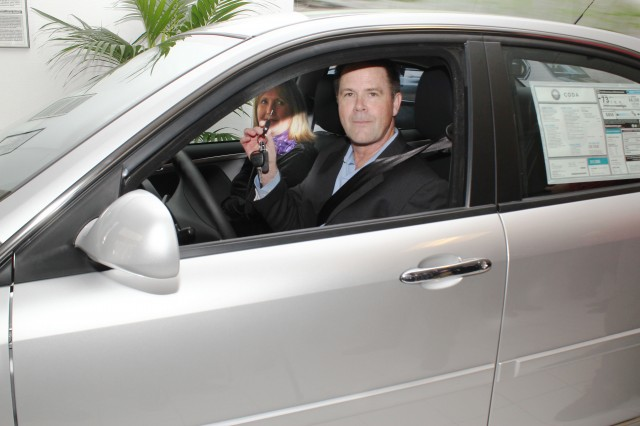 First delivery of 2012 Coda Sedan, at Coda Silicon Valley, to buyer Randy Abraham, March 2012