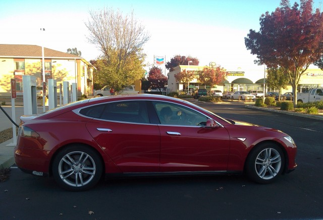 2013 Tesla Model S at Supercharger station in Corning, California, Nov 2013 [photo: George Parrott]