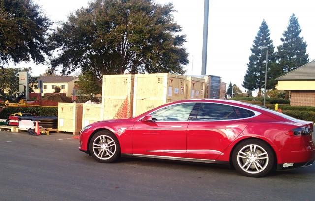 2013 Tesla Model S at nascent Supercharger station, Vacaville, CA, Nov 2013 [photo: George Parrott]