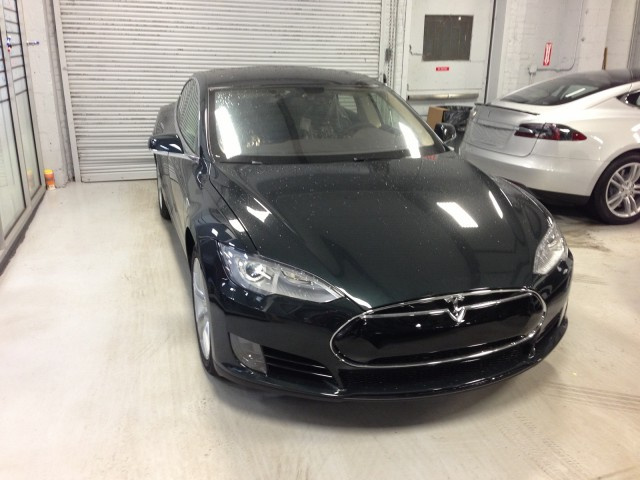 2013 Tesla Model S in Queens, NY, service center, awaiting delivery to buyer David Noland, Feb 2013