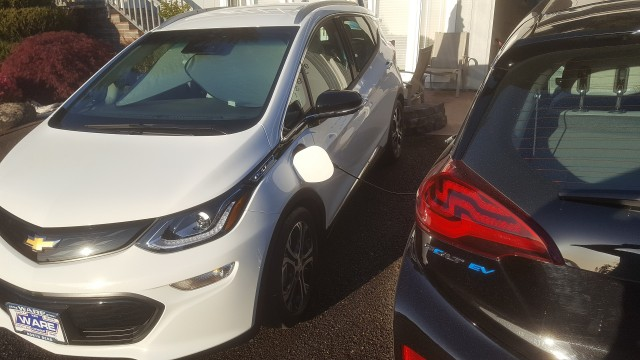 2017 Chevrolet Bolt EV electric cars charging in driveway [photo: Patrick Reid]
