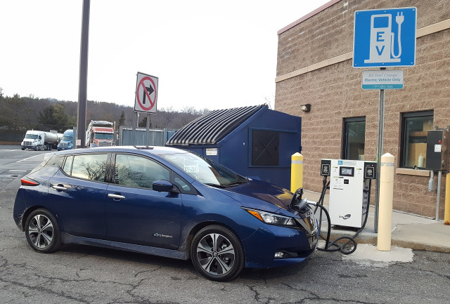 2018 Nissan Leaf With Greenlots Fast Charger By Dumpster At I 87 Modena Travel Plaza