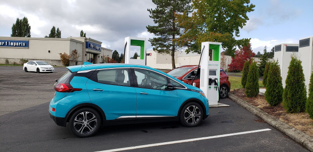2020 Chevrolet Bolt EV charging at Electrify America site, Kelso, Washington