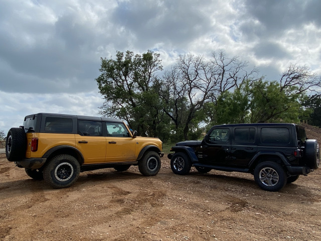 2021 Jeep Wrangler Sahara, black, and 2021 Ford Bronco Black Diamond, yellow