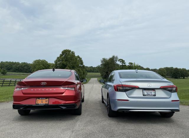 2022 Honda Civic Touring, blue, and 2021 Hyundai Elantra SEL, red