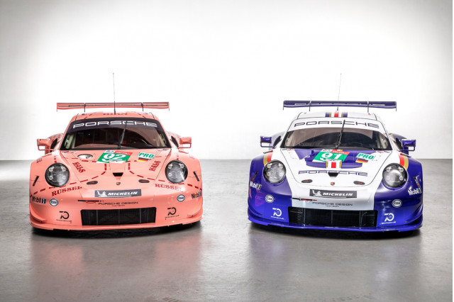 A pair of Porsche 911 RSR race cars in classic livery