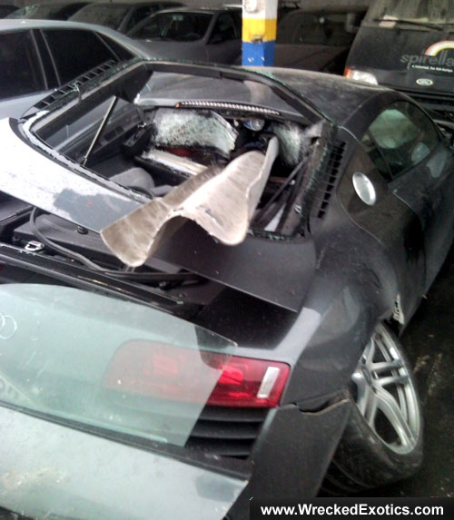 Audi R8 skewered on guardrail via WreckedExotics
