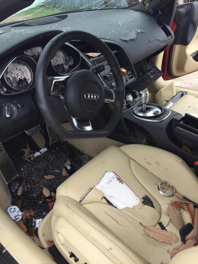 Audi R8 smashed by angry wife. Photo via GT Spirit.