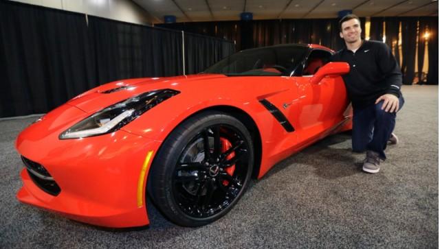Baltimore Ravens Quarterback Joe Flacco receives a 2014 Chevrolet Corvette Stingray