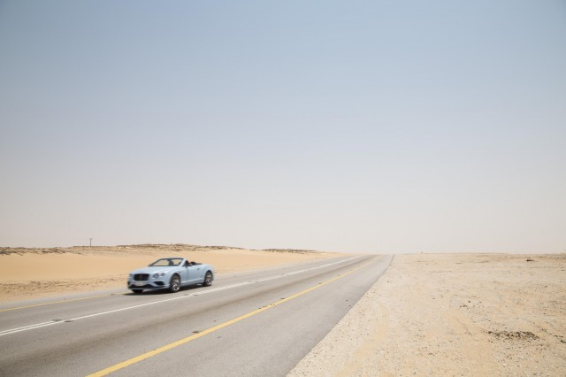 Bentley Continental GT races a train across Saudi Arabia