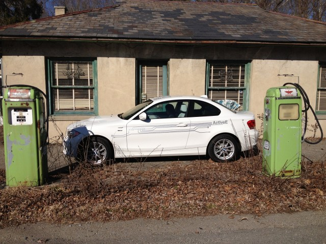BMW ActiveE electric car in front of old gas pumps, Belvidere, NJ   [photo: Tom Moloughney]