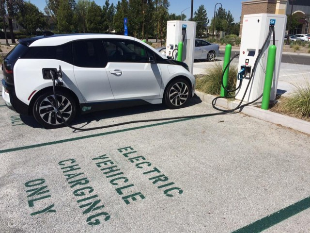 BMW i3 electric car charging in 'EV Charging Only' space, Santa Clarita, CA  [photo: Steve J. Myung]