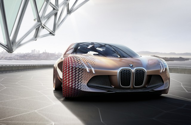 why bmw uses tesla electric cars to scare its staff into the future